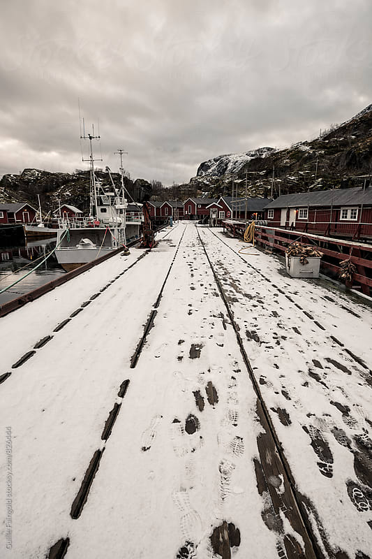 Nusfjord harbor in winter, Lofoten Islands. Norway by Guille Faingold for Stocksy United