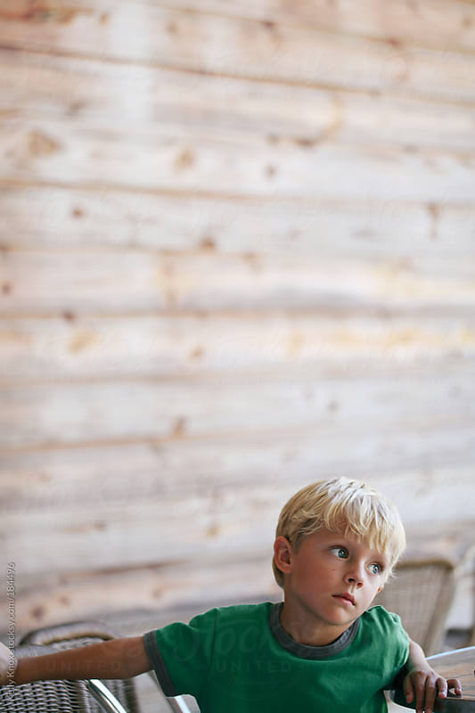 candid portrait of a young boy by Kelly Knox for Stocksy United
