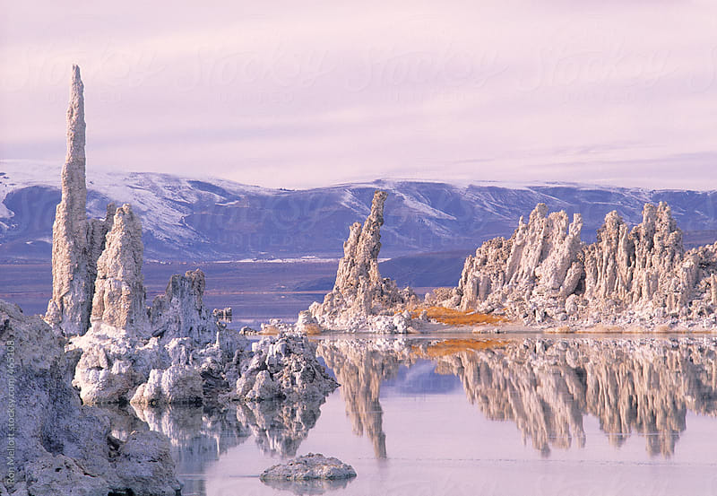 sunset at mono lake at sunset in winter saline briny salt formations by Ron Mellott for Stocksy United