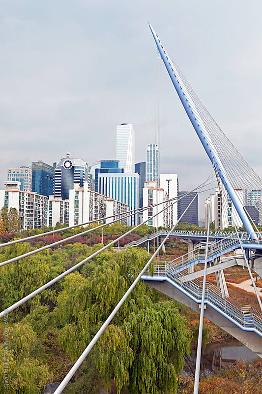 Seoul cityscape with bridge, Yeoui-do, Yeongdeungpo-gu, Seoul, Korea, Asia by Gavin Hellier for Stocksy United