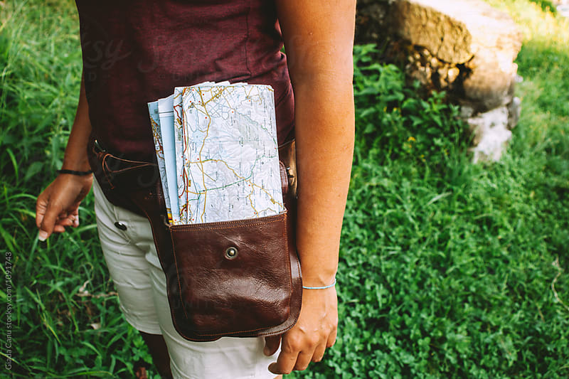 Woman with a map in her bag by Giada Canu for Stocksy United