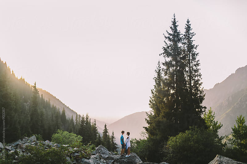 Young couple together on the top by Evgenij Yulkin for Stocksy United