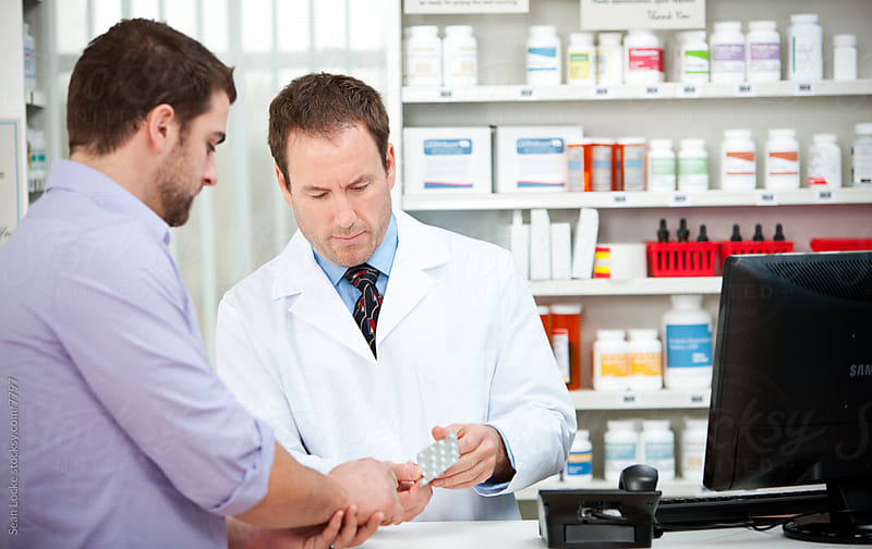 Pharmacy: Customer Asking Question About Pack of Pills by Sean Locke for Stocksy United