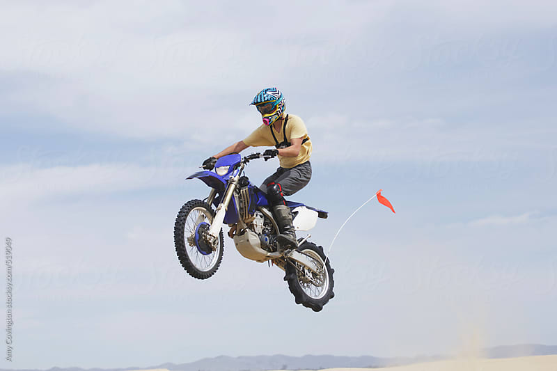 Young Man Jumping A Dirt Bike On The Sand Dunes By Amy Covington