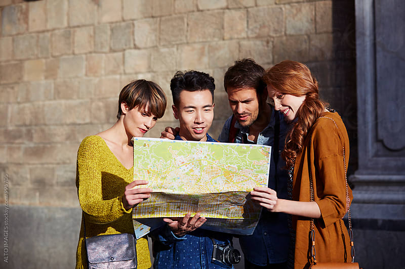 Happy Friends Looking At Map In City by ALTO IMAGES for Stocksy United