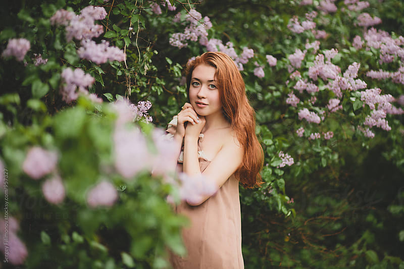 Portrait of the girl in blossom garden by Sergey Filimonov for Stocksy United