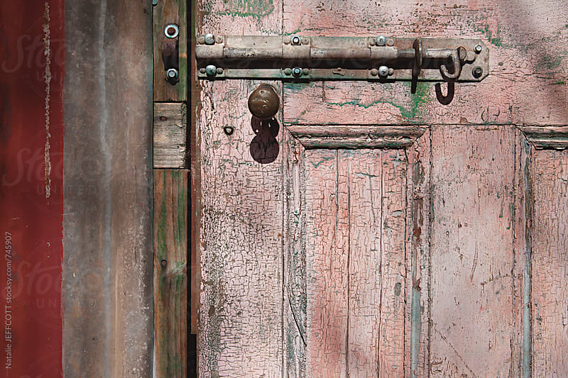 close up of old weathered door, handle and lock by Natalie JEFFCOTT for Stocksy United