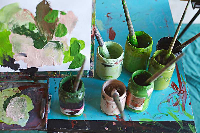 Shades of green paint and testing colours by Natalie JEFFCOTT for Stocksy United