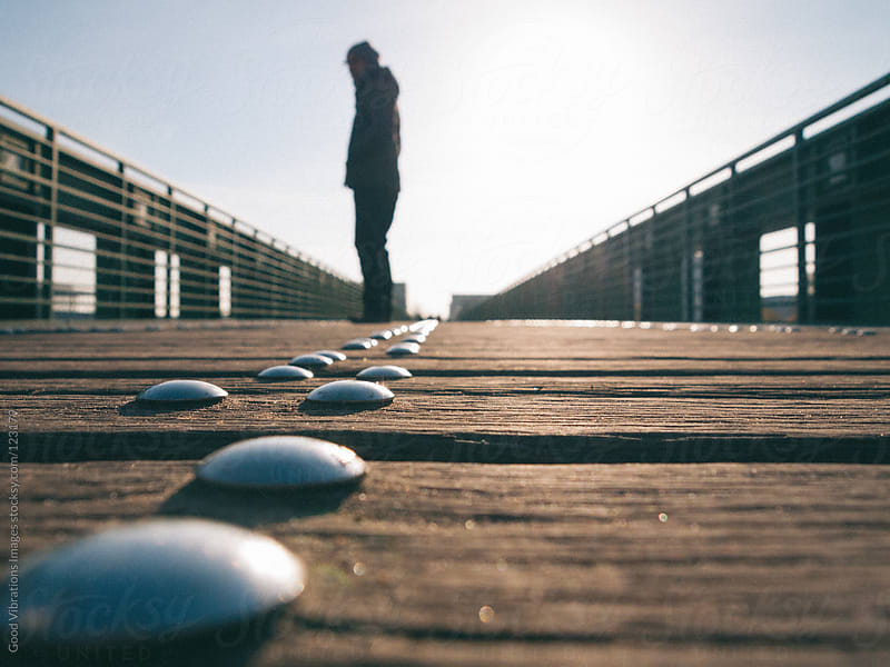 Solitary man on a Boardwalk by Good Vibrations Images for Stocksy United