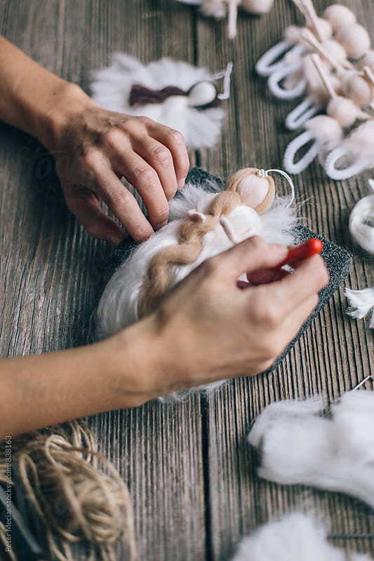 Handmade production of an angel made of merino wool by Peter Meciar for Stocksy United