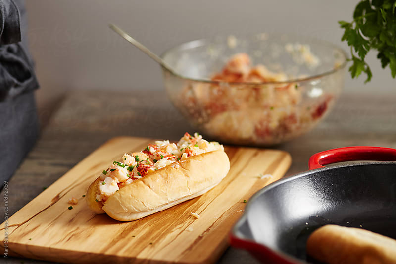 Lobster roll on wooden board by Martí Sans for Stocksy United