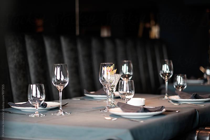 Wine Glasses on the Restaurant Table by Branislav Jovanović for Stocksy United
