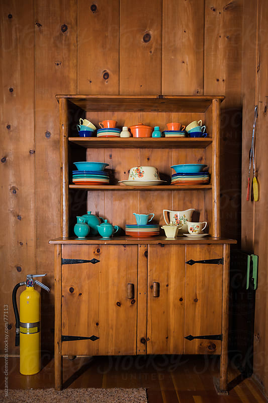 Set of Colorful, Antique Dishes in a Cabin by suzanne clements for Stocksy United