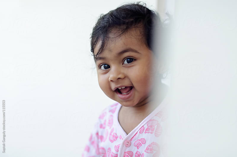 Cute baby girl smiling by Saptak Ganguly for Stocksy United