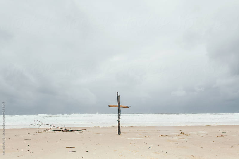 Wooden cross in the sand on the beach by Denni Van Huis for Stocksy United