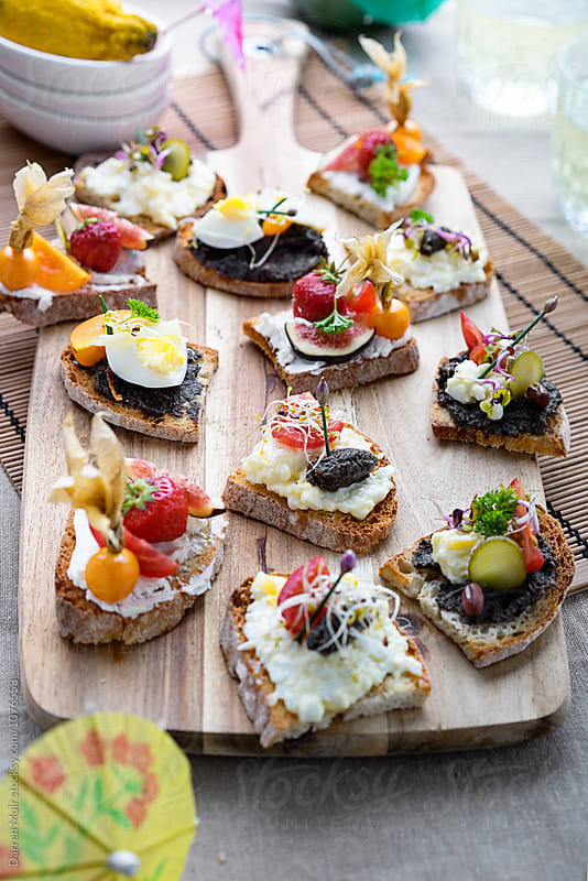 Canape party food,on serving board. by Darren Muir for Stocksy United
