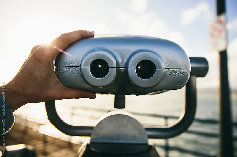 Binoculars first person view in a pier by Alejandro Moreno de Carlos for Stocksy United