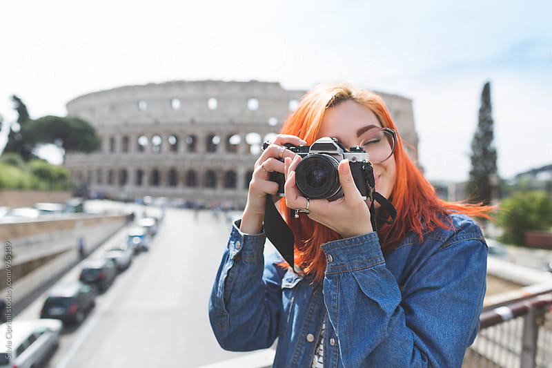 Young tourist taking pictures in Rome by Silvia Cipriani for Stocksy United