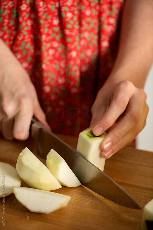 Making Apple Pie: Cutting the Apples by Jeff Wasserman for Stocksy United