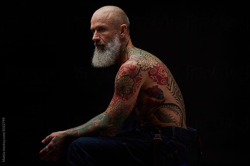 Man With Tatoo Studio Portraits  by Mattia Pelizzari for Stocksy United