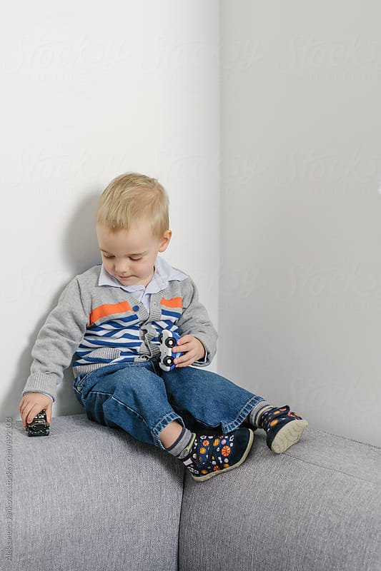 Cute Baby Boy Playing with Toy Cars by Aleksandra Jankovic for Stocksy United