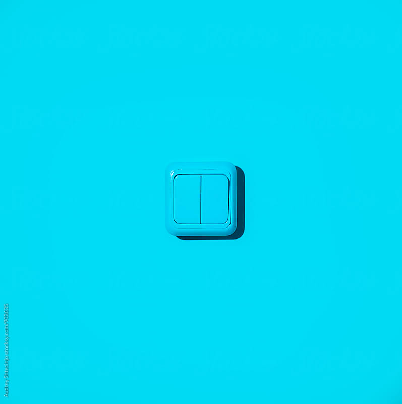Blue light switch on blue background. by Audrey Shtecinjo for Stocksy United