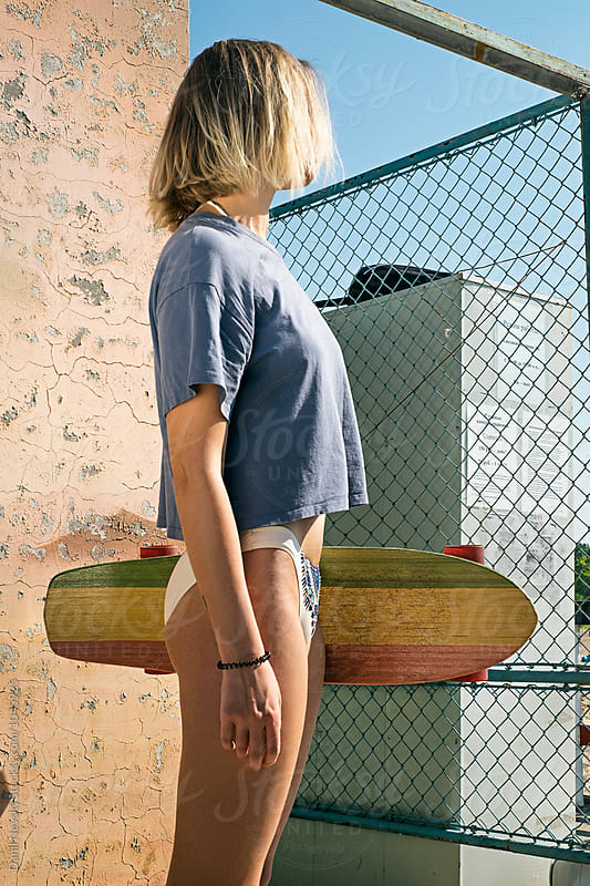 Girl in bikini bottom with colorful skateboard by T-REX & Flower for Stocksy United