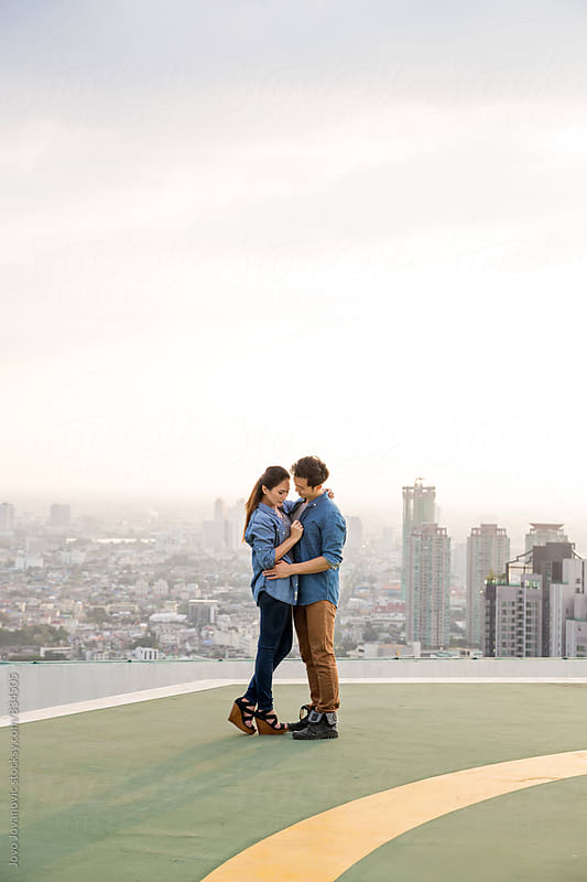 Couple in love hugging on helipad  by Jovo Jovanovic for Stocksy United