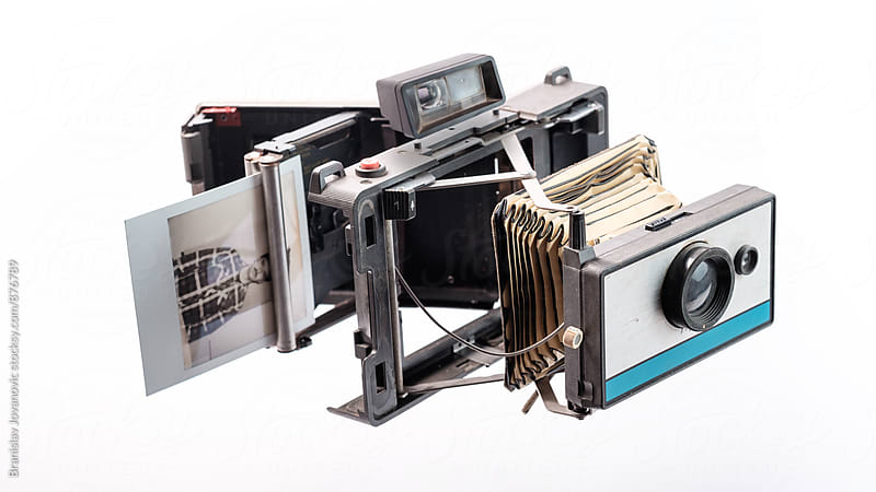 Disassembled Old Polaroid Camera on the White Background by Branislav Jovanović for Stocksy United