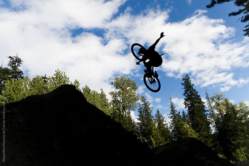 Bike jump silhouette. No hander on dirt jumps by Alejandro Moreno de Carlos for Stocksy United