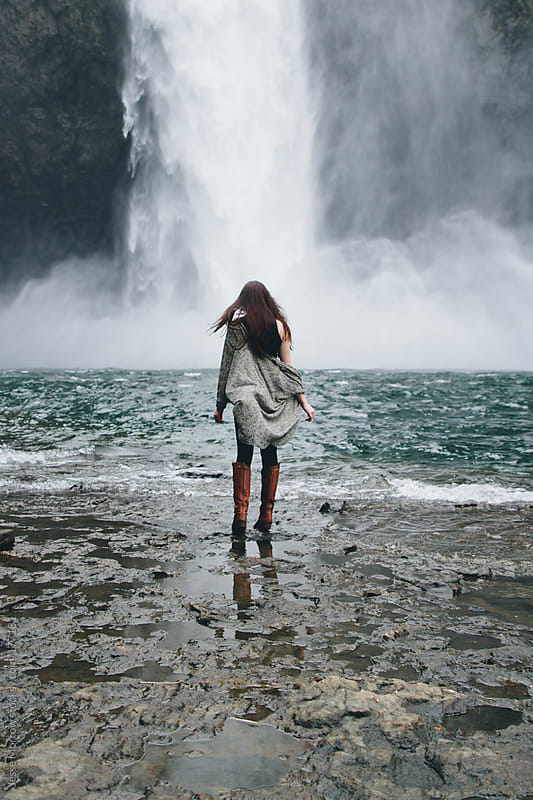 Young woman in front of waterfall by Jesse Morrow for Stocksy United