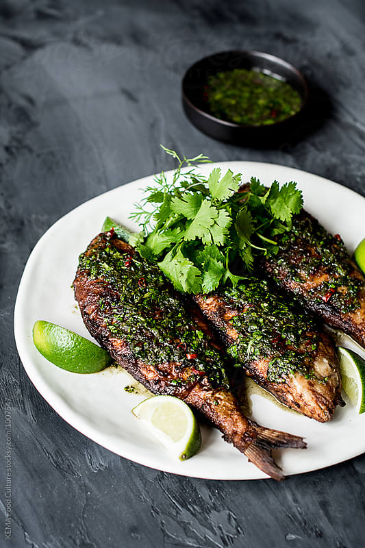 Fried sea bream with coriander, chily and fish sauce  by KEMA Food Culture for Stocksy United