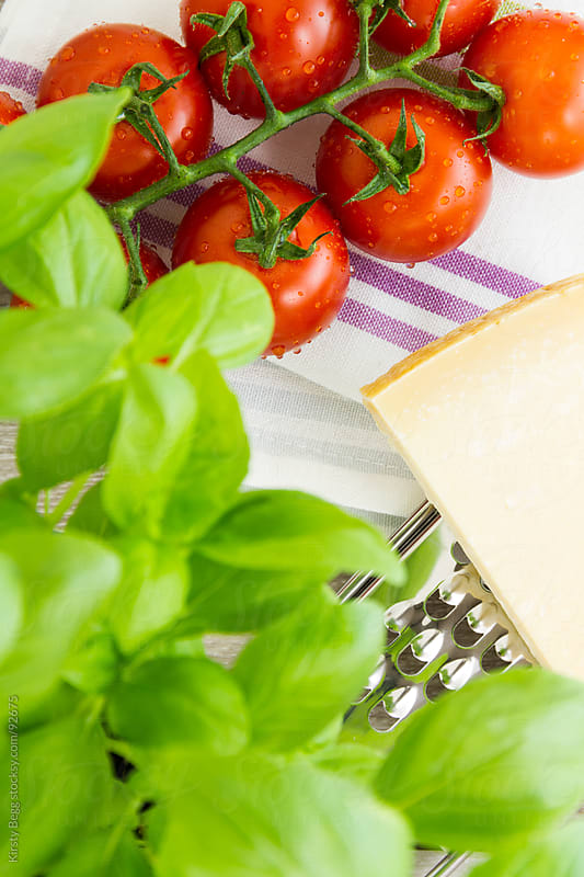 Basil, tomato and parmigiano reggiano by Kirsty Begg for Stocksy United
