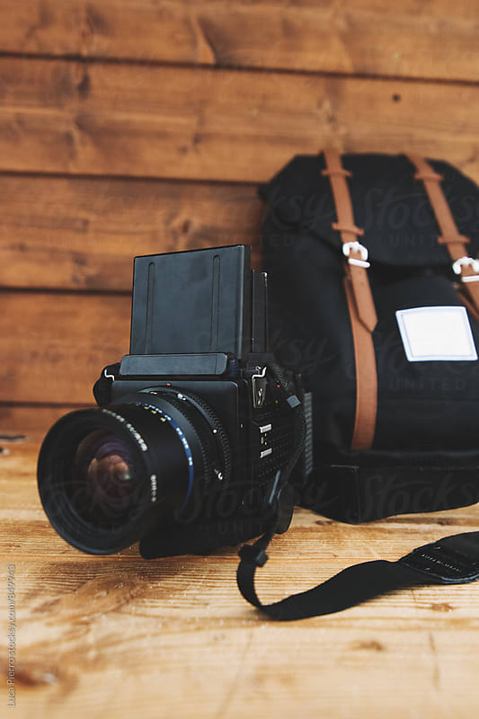 Film camera and backpack by Luca Pierro for Stocksy United
