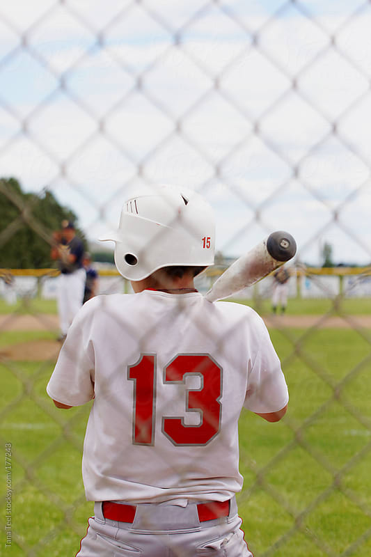 A baseball players waits to bat by Tana Teel for Stocksy United