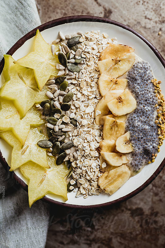 Muesli with carambola, seeds and dried banana by Tatjana Ristanic for Stocksy United
