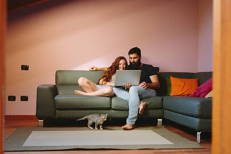 Couple at home with a laptop by Good Vibrations Images for Stocksy United