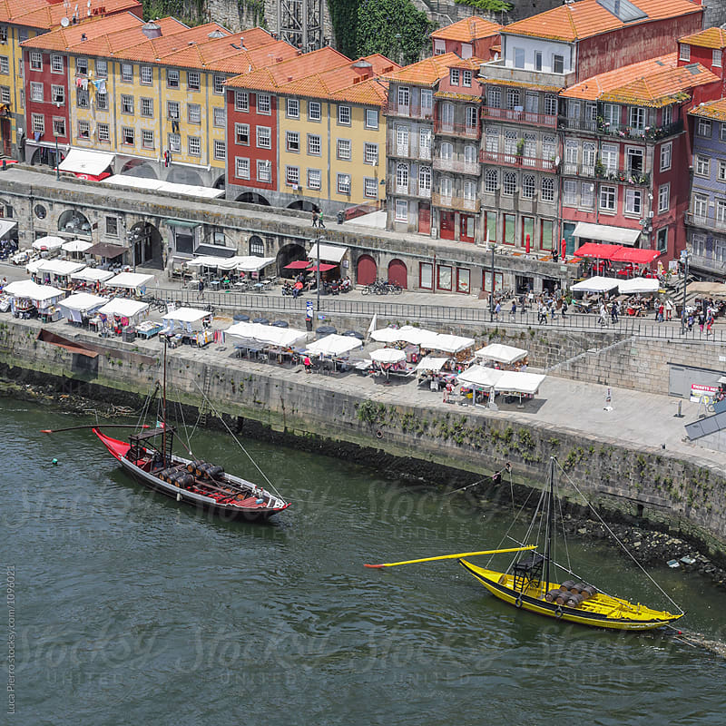 View of the old Ribeira, along the Douro river, with Rabelo boats. Porto (Portugal)  by Luca Pierro for Stocksy United