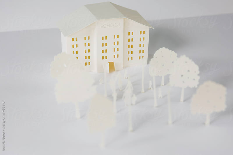 School building cut out of paper with its surroundings by Beatrix Boros for Stocksy United