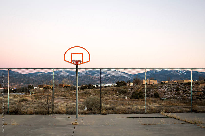 A basketball court in New Mexico at dusk by Ann-Sophie Fjelloe-Jensen for Stocksy United