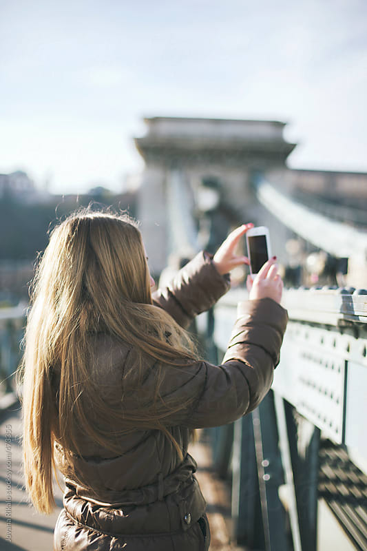 Young woman taking photos  of city by Jovana Rikalo for Stocksy United
