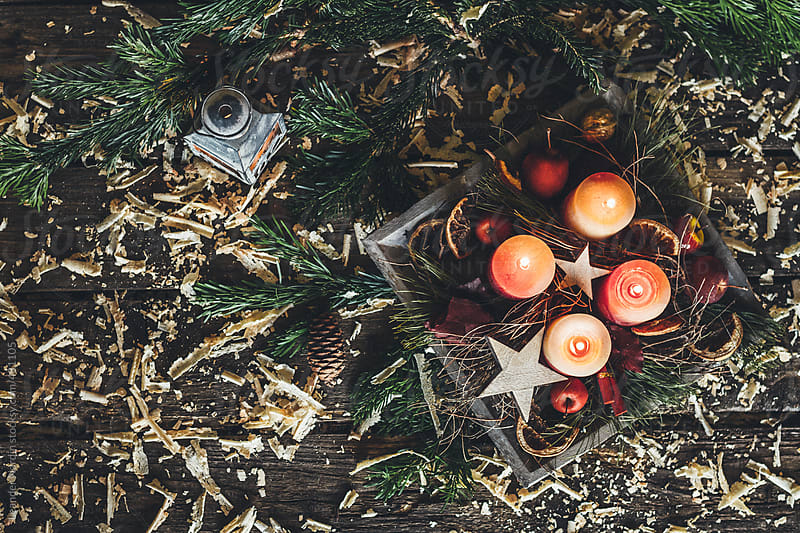 first Sunday in Advent - the first candle is burning on the advent wreath from above by Leander Nardin for Stocksy United