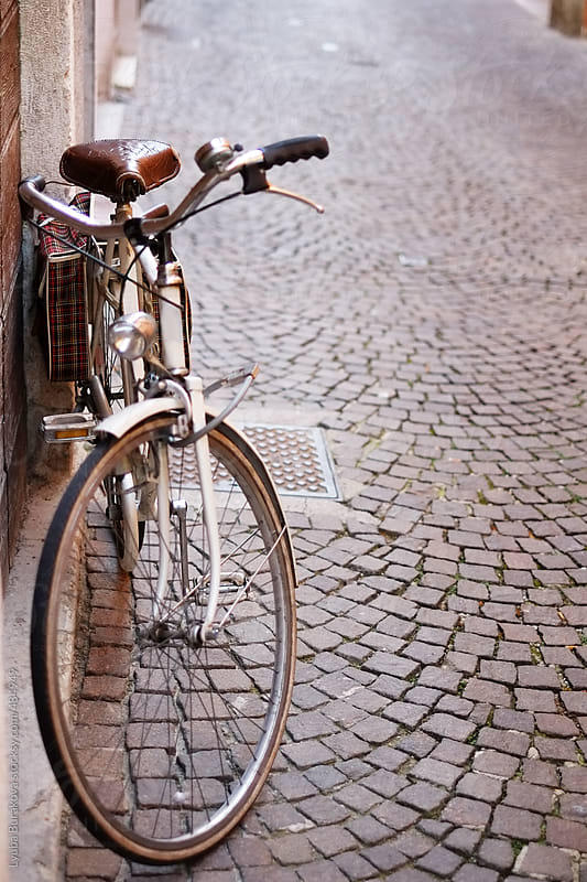 Vintage bicycle on the paved street in Italy by Lyuba Burakova for Stocksy United
