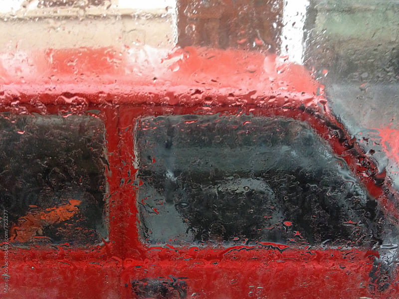 Red car through the wet window by Marija Kovac for Stocksy United
