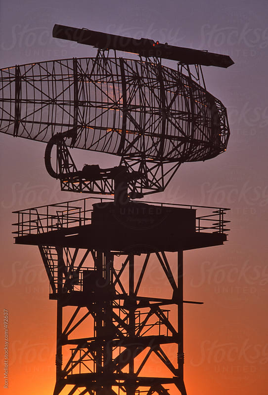 radar antennae silhouette sunset prairies near Regina, Saskatchewan, Canada by Ron Mellott for Stocksy United