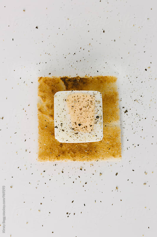 Cubed egg on square toast, concept shot for something different by Kirsty Begg for Stocksy United