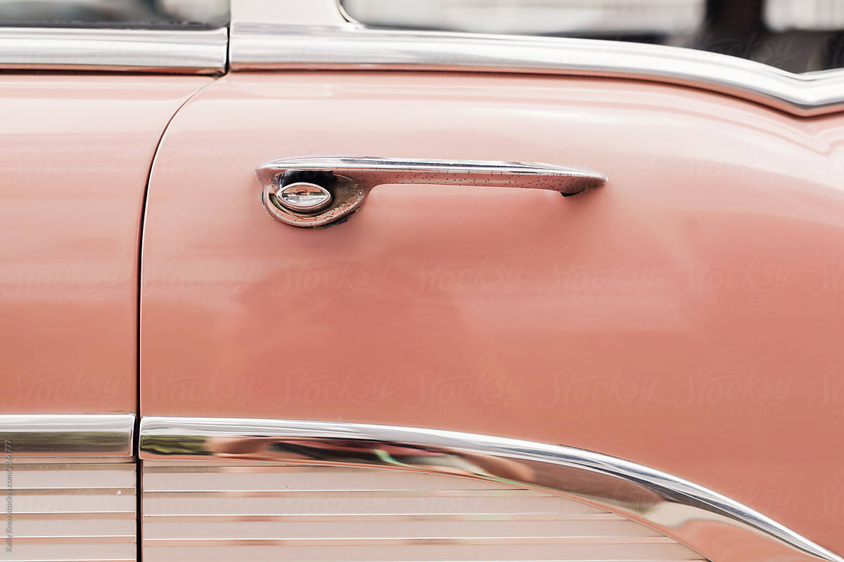 door detail on a pink vintage car by Kelly Knox for Stocksy United - Door Detail On A Pink Vintage Car Stocksy United