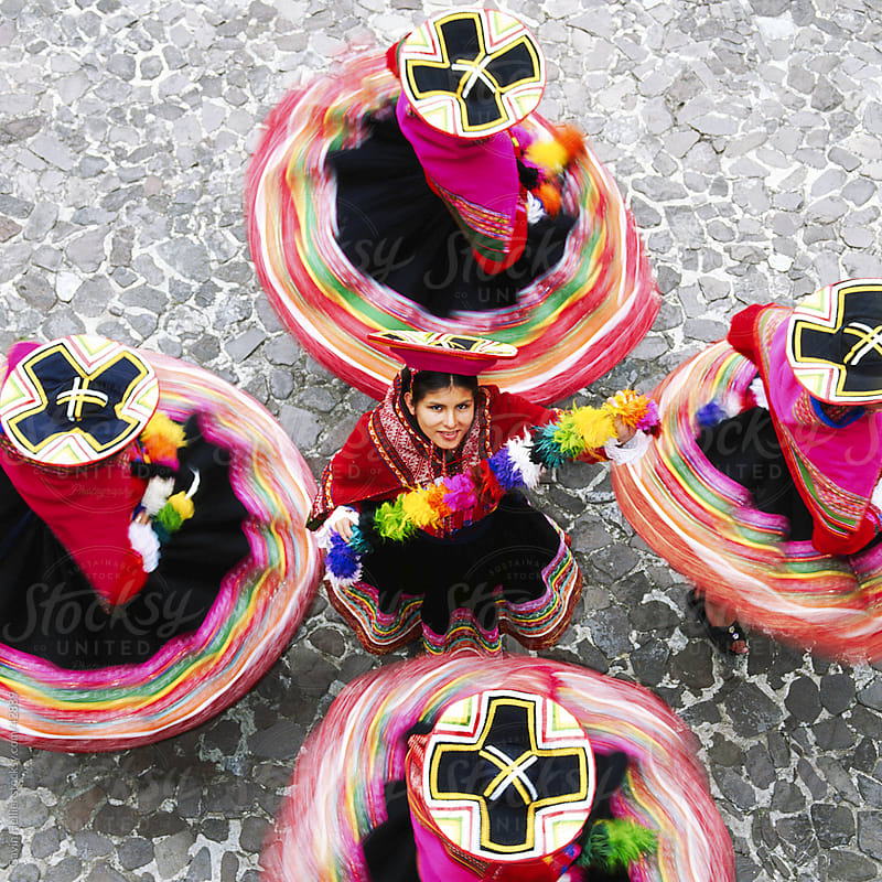 Overhead view of Mestiza Cuzquena dancers in motion, Cuzco (Cusco), Peru, South America by Gavin Hellier for Stocksy United