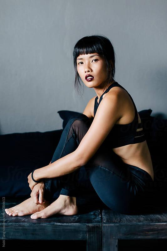 Asian woman in black sportswear by Nabi Tang for Stocksy United