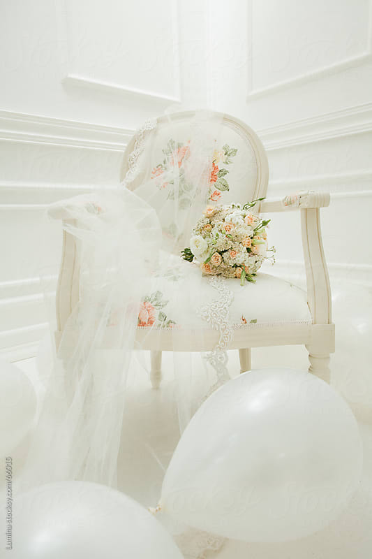 Bride's Bouquet and Veil on an Armchair by Lumina for Stocksy United